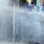 Fireman fighting a fire at a distillery